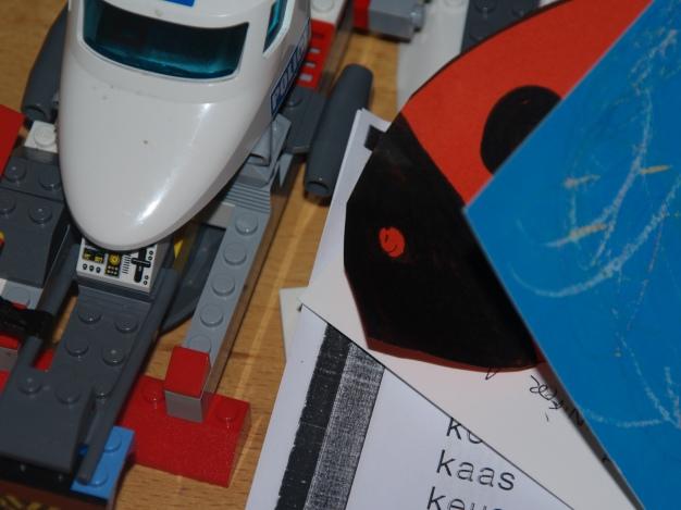 Zoek het lieveheersbeestje tussen het speelgoed
